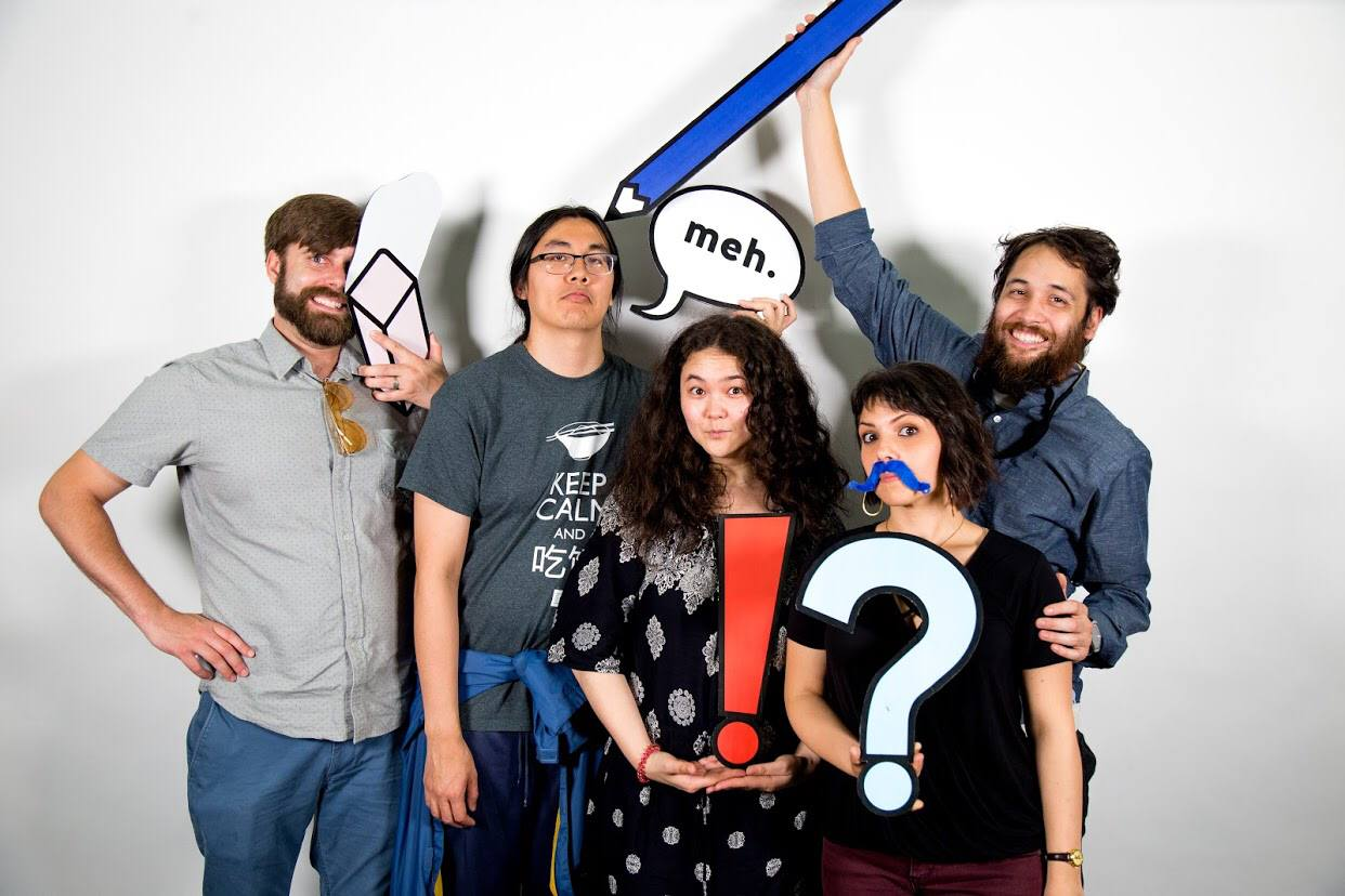 Five of our co-op members are posing for a photo with quirky, design-inspired props. Left to right: Cooper, Gabe, Roxanne, Xio, and Dante.